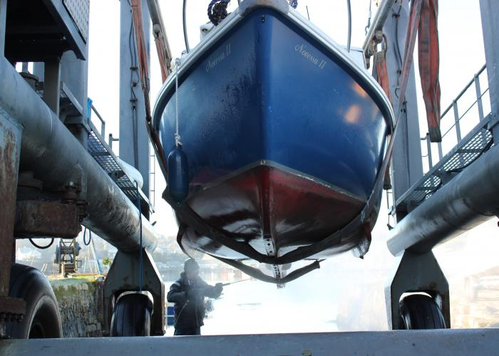 Launching boat in Falmouth Cornwall
